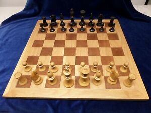 Vintage wooden chess pieces with Board.