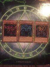 Yugioh God Cards - PGLD-EN031/2/3 Slifer, Obelisk, Ra - Gold Secret Rare Set