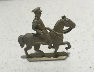 antique toy lead officer on horse