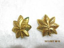 Military officers gold oak leafs for a officer please see pictures