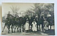 Vintage RPPC Biskra (Algeria) Tour Group, Camels 1920's Sepia photo.