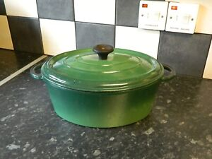 cast iron  casserole dish and lid in green
