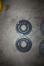 Pair of 2 1/2 pound Olympic plates, 1.3 kilos