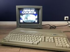 Atari 1040 ste + moniteur Sc 1435 + 2 Joysticks + 4 jeux + câbles