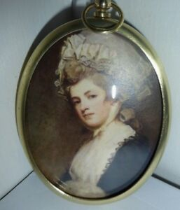 Miniature portrait of Perdita Robinson in an elaborate hat in a brass frame