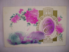 VINTAGE EMBOSSED EASTER POSTCARD SILHOUETTE BUNNIES WITH NICE EASTER COLORS