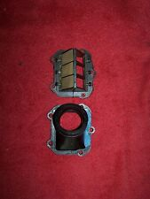 86 KTM 250 MX CARBURETOR INTAKE AND REED CAGE