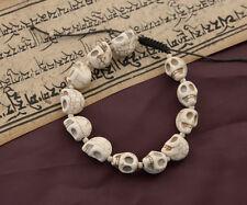 Bracelet mala tibetain tete de mort blanc creme 11 à 12 perles 4130