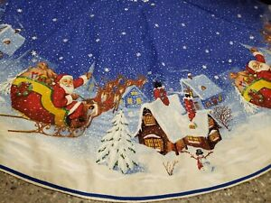 Large Blue and White Christmas tree skirt, Santa flying over the town approx 52""