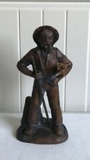 Resin Sculpture Of Elderly Man Holding A Bundle Of Hay & A Stick
