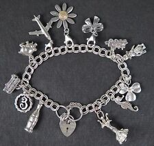 Silver charm bracelet with 12 travel and good luck charms.