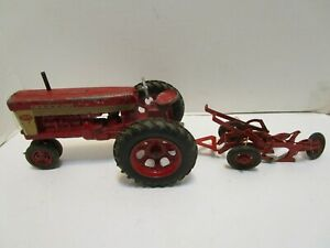 VINTAGE FARMALL 560 FARM TRACTOR WITH McCORMICK TRACTOR PLOW