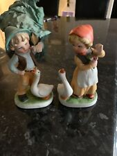 Boy And Girl Figurines With Geese