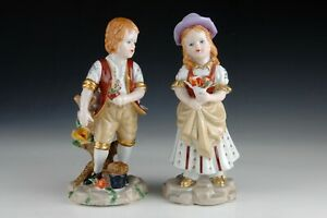 """Pair of enameled porcelain figurines. """"Children with flowers"""". Inspired by model"""