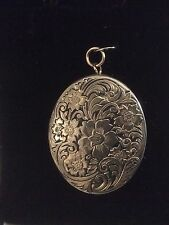 LARGE OVAL LOCKET - BEAUTIFULLY FLORALBROCADED COVER- CLEAR BACK unengraved
