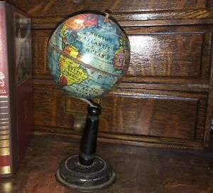 Antique German 1930s terrestrial world globe, in multicolor lithograp tin.Small