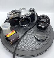 Olympus OM10 35MM SLR Film CAMERA & OLYMPUS 50mm ZUIKO F1.8 LENS+STRAP+FILM/++++