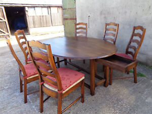 BESPOKE SOLID OAK WAKES  DINING TABLE AND SIX LADDERBACK CHAIRS WITH CUSHIONS
