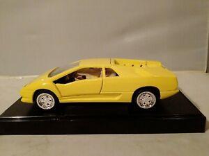 Yellow Lamborghini Diablo Model 1/24 on a plinth great model great price