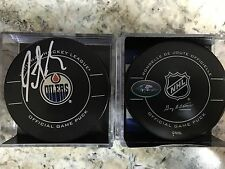 SIGNED AUTOGRAPHED OFFICIAL NHL GAME PUCK EDMONTON OILERS JUSTIN SCHULTZ