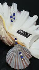 One of a kind serling silver, lapis lazuli & shell necklace and earring set.