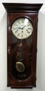 Howard Miller Ambassador Collection Dark Brown Wood Pendlum Chime Wall Clock