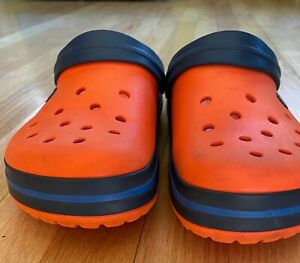 Crocs  Unisex size 9 and 11. Orange with blue stripe