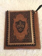 Vintage hand tooled leather pen and paper holder. With shield on the front