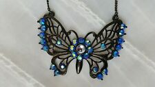 Black butterfly necklace with blue glass embellishments