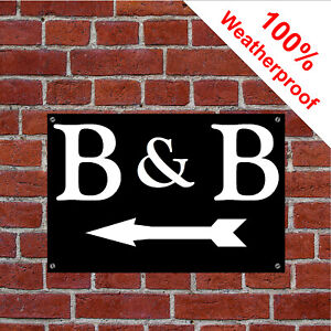 B&B sign with left facing arrow sign Hotel Guesthouse Bed and Breakfast 1974WBK