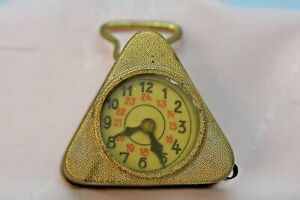 Antique triangular carriage clock tape measure, plated brass and steel, German