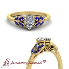 Pear Shape Diamond Leaf Inspired Engagement Ring With Sapphire Gemstones 0.65 Ct