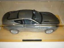 A Danbury mint, Aston Martin V12 Vanquish, with a display case Die another day