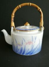 Vintage FlowerTeapot with bamboo handle.
