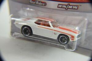 1.hot wheel, FROM phil's garage 69 camaro, white .NIP