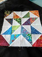 batik and white spinning star quilt blocks