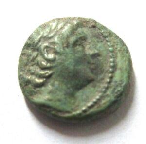 Ae-14 of Antiochos VIII (Seleucid)   Rv. Apollo seated left