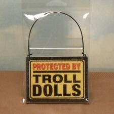 """Wooden hanging Troll Doll sign says """"Protected by Troll Dolls"""": yellow/red/wire"""