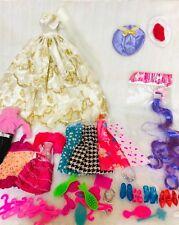 40 items  Includes 10PCS CLOTHES  + 8 Pair shoes +6 PCS hangers + 24Accessories