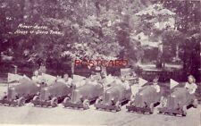 children sitting in MIDGET AUTOS, HOUSE OF DAVID PARK, BENTON HARBOR, MICHIGAN