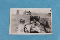 VINTAGE RPPC REAL PHOTO POSTCARD NUDE BABY AT FARM ON CHAIR WITH SISTER