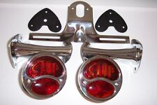 1928-31 model A lights with STOP script, brackets, & license bracket.