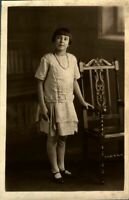 Antique RPPC postcard real photograph portrait of an adorable girl by oak chair