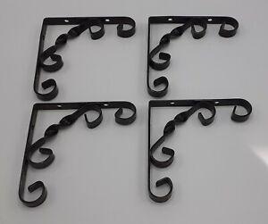 Four Small Black Metal Decorative Garden Brackets