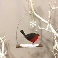 Single robin on a branch.Hanging Christmas decoration.Shoeless joe. Shabby chic