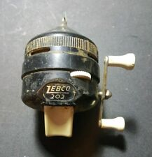 Vintage Zebco Reel 202 classic with metal foot, black and white U.S.A.
