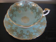 PARAGON TURQUOISE GOLD FLORAL CHINTZ TEACUP AND SAUCER