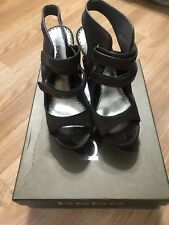 Chocolate brown Worn Stiletto Heels by Bebe - Size 5 come with box.