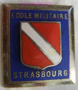 IN13506 - INSIGNE Ecole Militaire de Strasbourg, émail, relief, dos guilloché