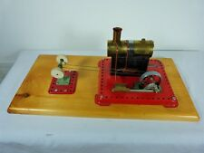 MAMOD STEAM ENGINE LARGE WITH ATTACHED BUFFING WHEELS AND MOUNTED ON PINE BOARD